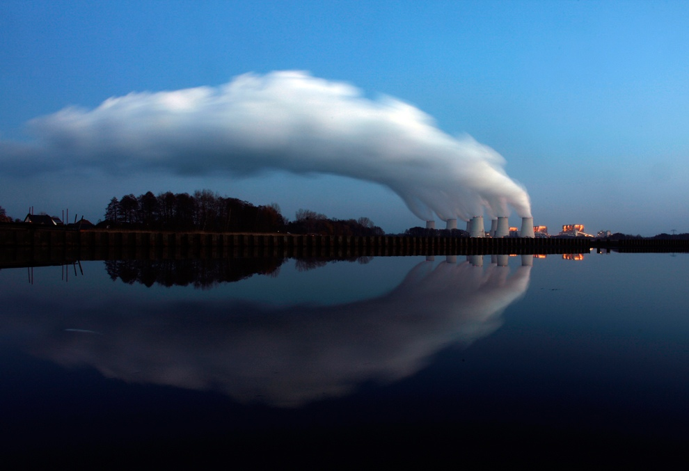 Steam billows from the cooling towers of Vattenfall's Jaenschwalde brown coal power station on a lake near Cottbus, eastern Germany. (REUTERS/Pawel Kopczynski)
