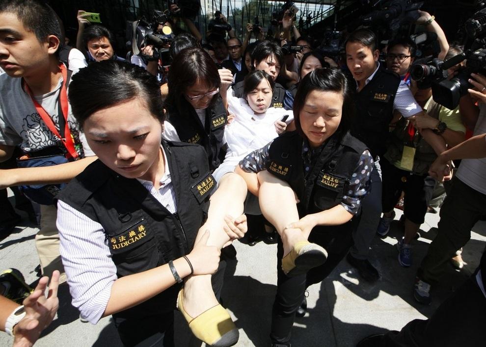 Падение последнего оплота движения Occupy. (AP Photo/Kin Cheung)