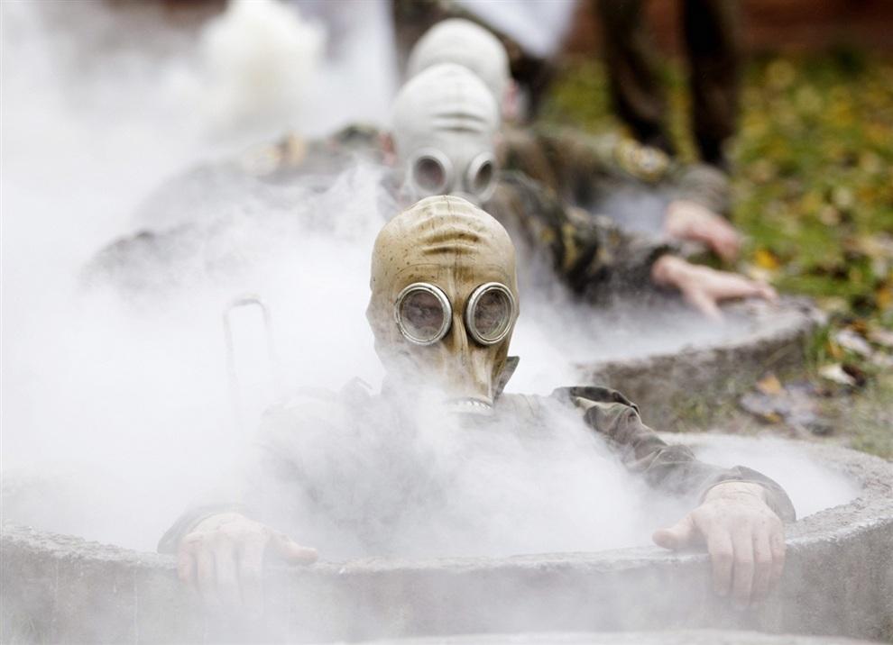 Испытания спецназовцев на получение крапового берета в деревне Горани, Белоруссия. (REUTERS/Vasily Fedosenko)