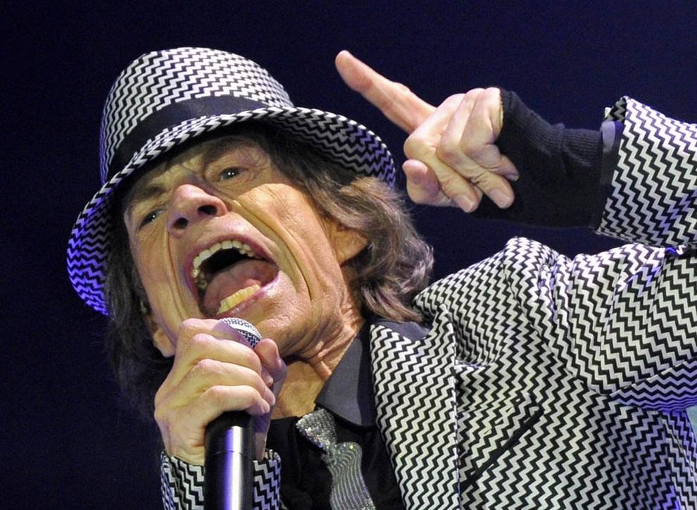 Вокалист The Rolling Stones Мик Джаггер на концерте в Лондоне, Англия. (REUTERS/Toby Melville)