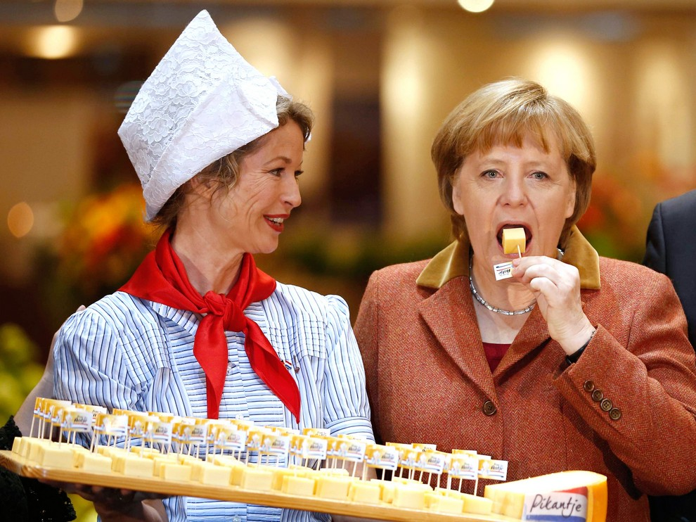 German Chancellor Angela Merkel samples cheese at pavilion of Netherlands at Green Week agricultural fair in Berlin