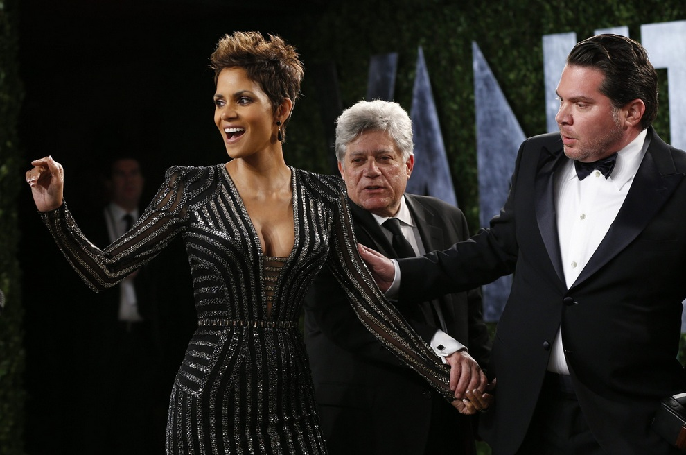 Halle Berry is guided to pose at the 2013 Vanity Fair Oscars Party in West Hollywood