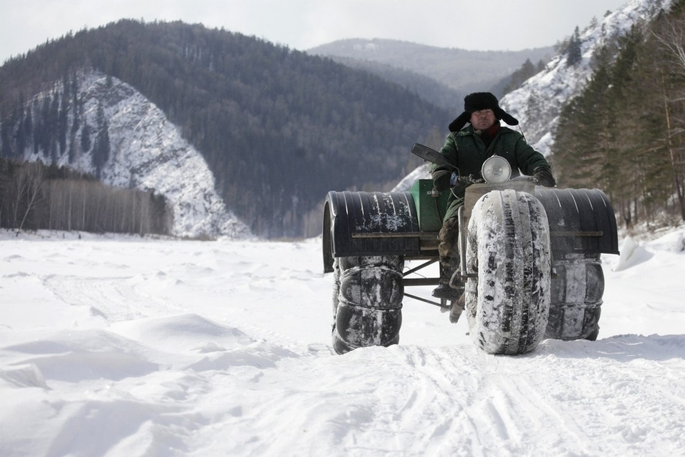 "Yushkov drives his self-made three-wheeled cross-country vehicle called ""Bolivar"" along the frozen Mana river near Krasnoyarsk"