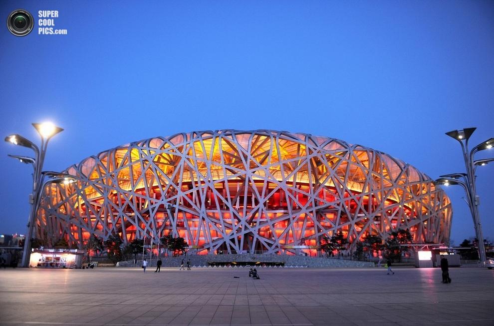Пекинский национальный стадион, также известный как «Птичье гнездо», Китай. (WANG ZHAO/AFP/Getty Images)
