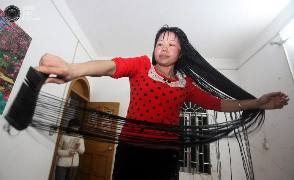 Длинноволосая Цэнь Инюань. (EPA/XUE QIAO)