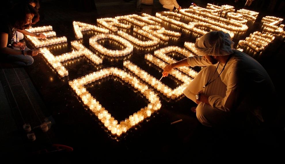 Emiratis light candles to mark Earth Hour near Burj Khalifa in Dubai