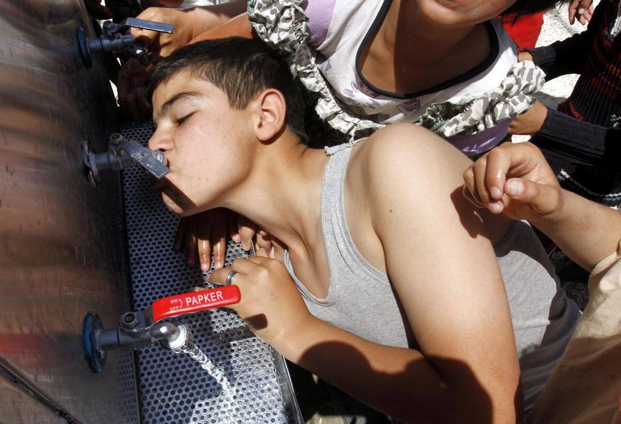 Мираджеб аль-Фохуд — лагерь сирийских беженцев в Иордании (10 фото)