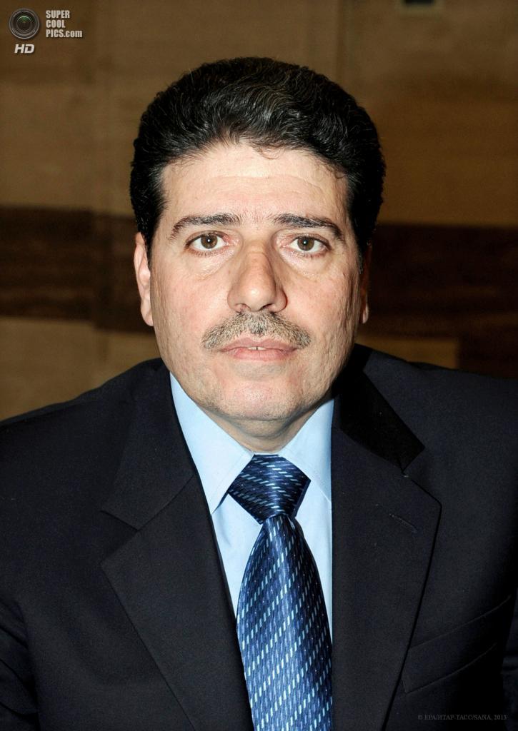 Премьер-министр Сирии Ваиля аль-Халки. (EPA/ИТАР-ТАСС/SANA)