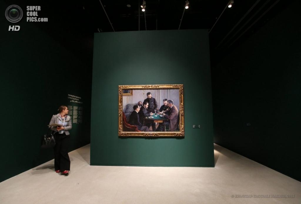 ОАЭ. Абу-Даби. 16 апреля. Картина «Игра в безик» французского художника Гюстава Кайботта. (EPA/ИТАР-ТАСС/ALI HAIDER)