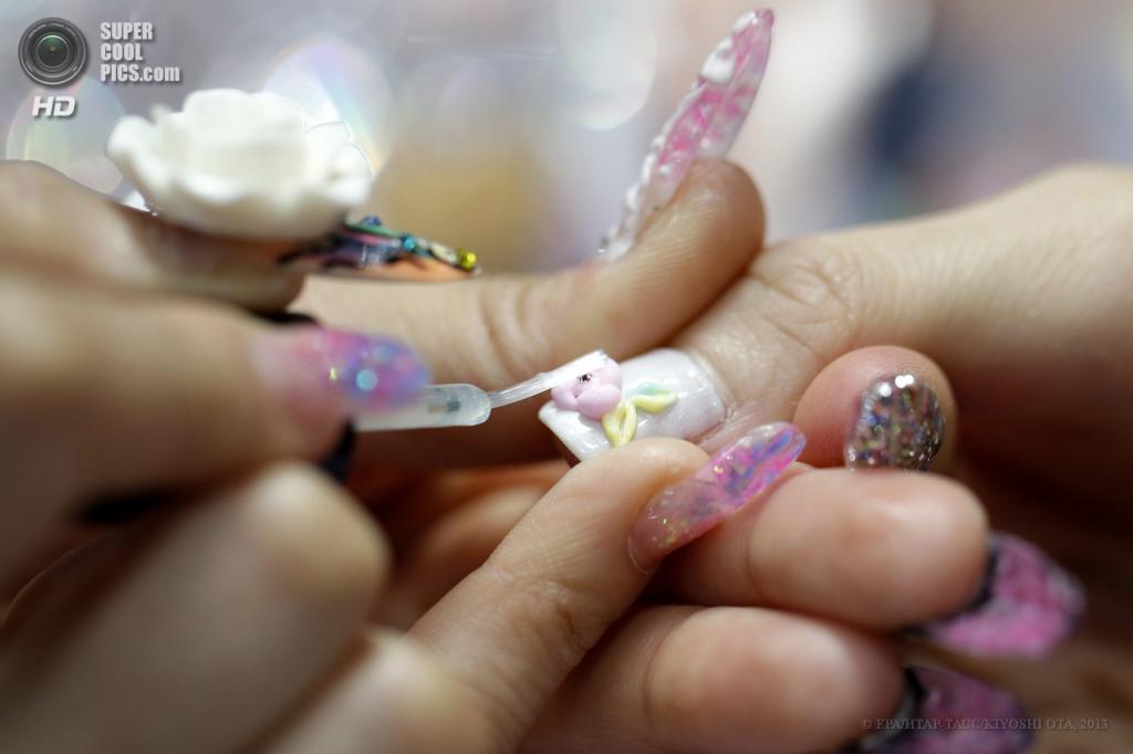Япония. Токио. 13 мая. На 15-й выставке индустрии красоты и косметологии Beautyworld. (EPA/ИТАР-ТАСС/KIYOSHI OTA)