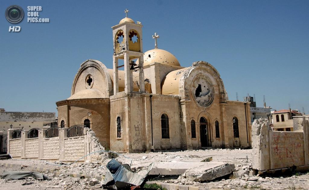 Сирия. Эль-Кусейр, Хомс. 5 июня. После восстановления контроля над городом  сирийской армией. (EPA/ITAR-TASS/STR)