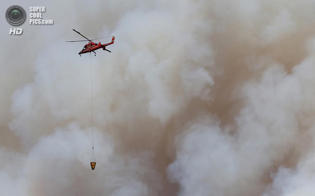 США. Гровленд, Калифорния. 22 августа. Поддержка с воздуха. (Justin Sullivan/Getty Images)
