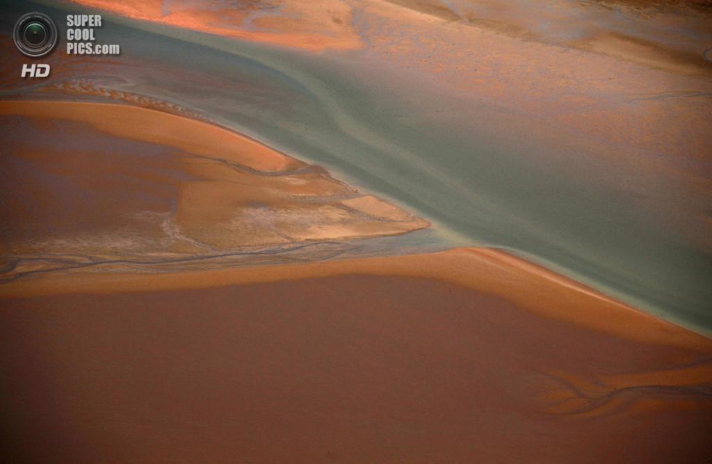 Австралия. Арнем-Ленд, Северная территория. 15 июля. Пляж на побережье залива Карпентария. (REUTERS/David Gray)