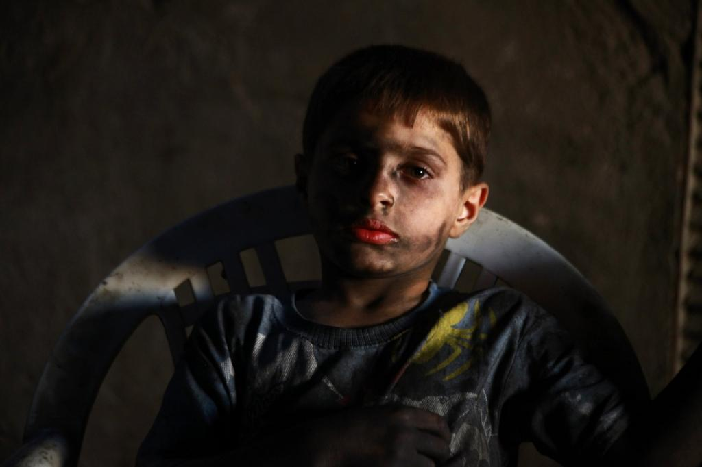 Issa poses for a picture while resting in a weapons factory of the Free Syrian Army in Aleppo