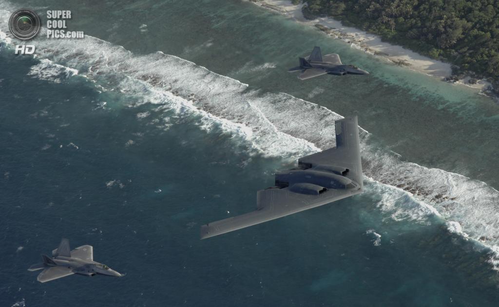 Northrop Grumman B-2 Spirit в сопровождении истребителей Lockheed Martin F-22 Raptor. (USAF Photo/Master Sgt. Kevin J. Gruenwald)