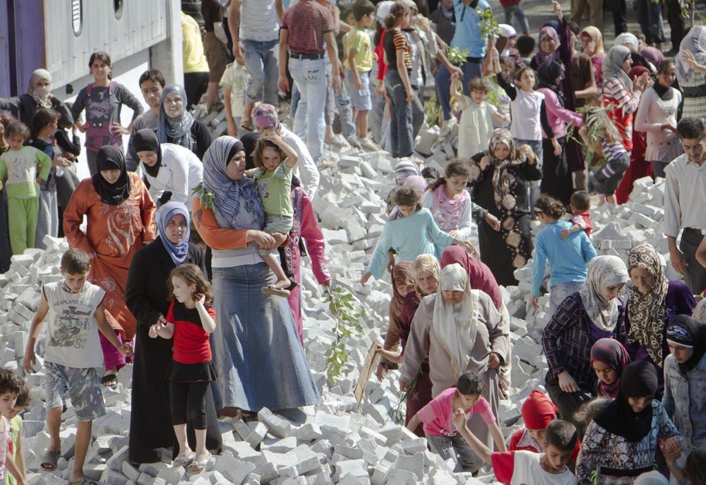 Положение сирийских беженцев (13 фото)