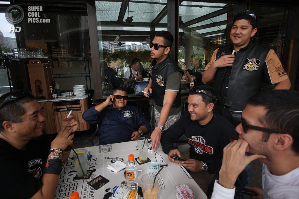 Малайзия. Куала-Лумпур. 16 сентября. На фестивале Asia Harley Days 2013. (Rahman Roslan/Getty Images)