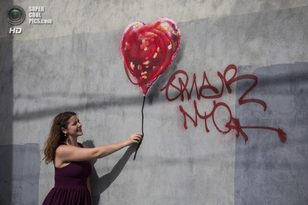 США. Нью-Йорк. 7 октября. Новые работы Бэнкси. (Andrew Burton/Getty Images)