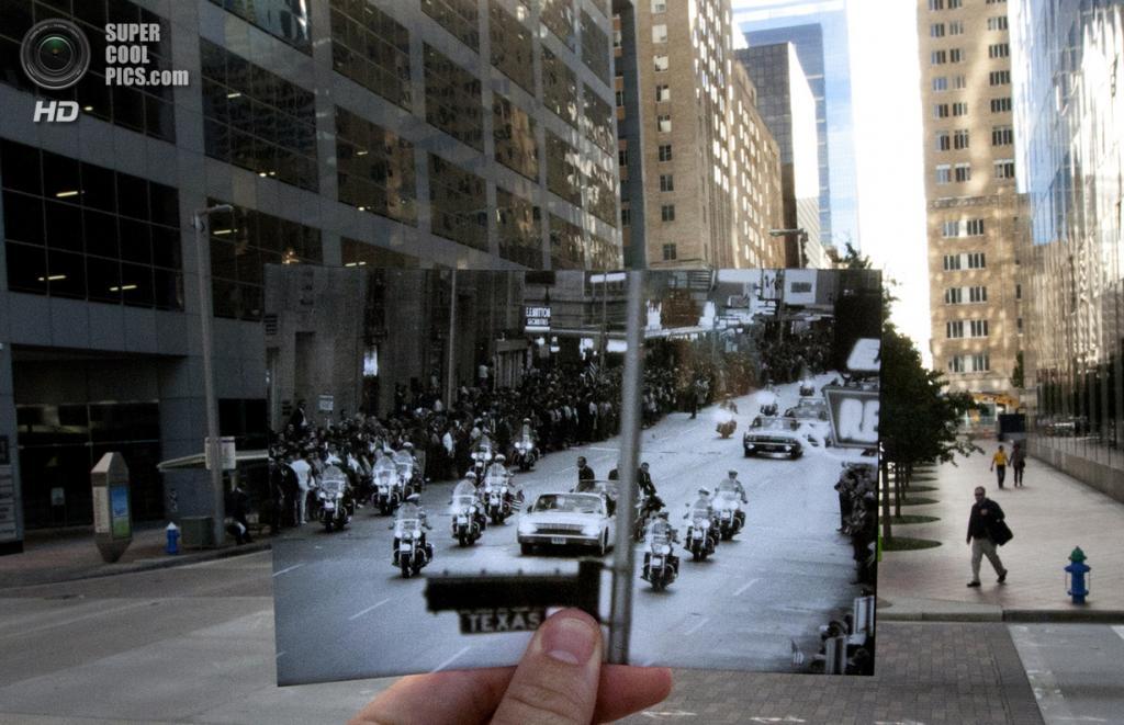 США. Даллас, Техас. 7 ноября. Репортёр с фотографией автоколонны Джона Кеннеди. (AP Photo/Houston Chronicle, Cody Duty)