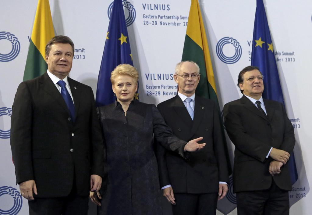 Ukrainian President Yanukovich is welcomed by Lithuanian President Grybauskaite, European Council President van Rompuy and European Commission President Barroso at the EU Eastern Partnership summit in Vilnius