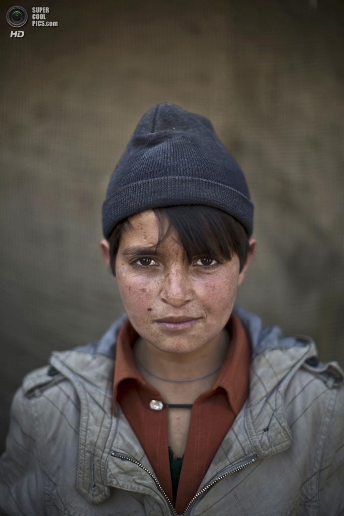 Абдулрахман Бахадир, 13 лет. (AP Photo/Muhammed Muheisen)