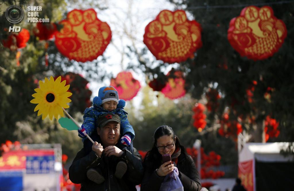 Китай. Пекин. 30 января. В преддверии Китайского Нового года. (REUTERS/Kim Kyung-Hoon)