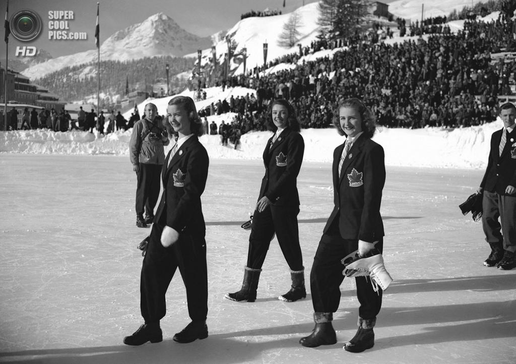 Швейцария. Санкт-Мориц, Граубюнден. 30 января 1948 года. Барбара Энн Скотт, Марион Рут Тейк и Сьюзан Морроу (слева направо) из Канады во время парада делегаций на церемонии открытия V Олимпийских зимних игр. (AP Photo)