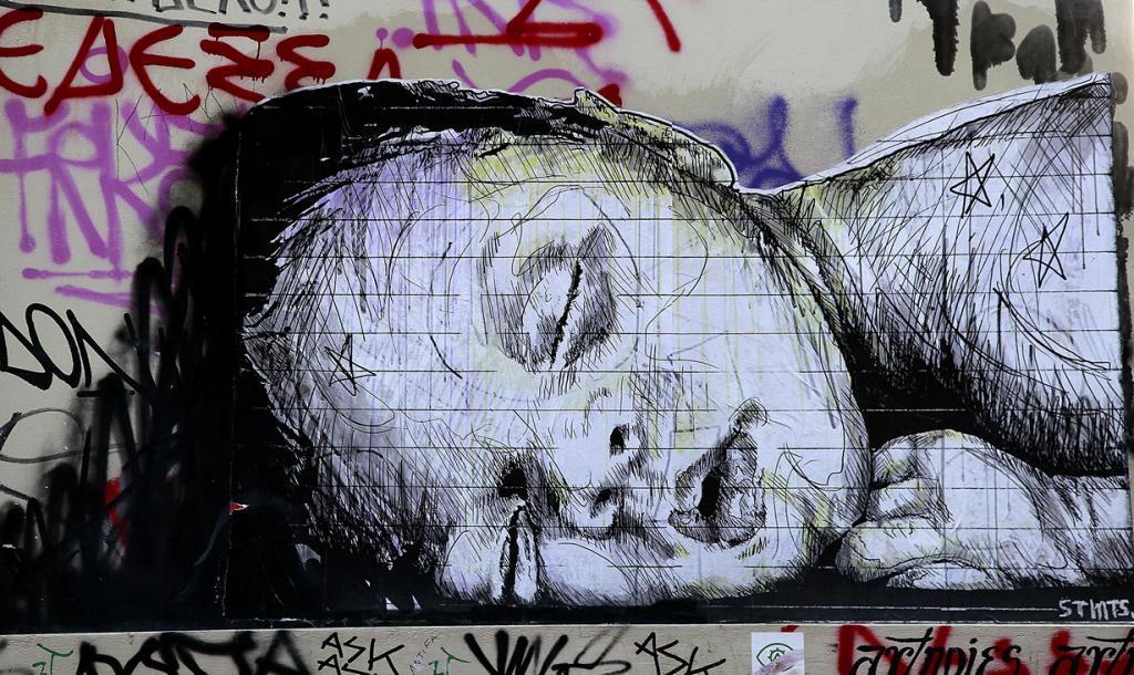 Греция. Афины. 17 февраля. Граффити «Сон» уличного художника SMTS в афинском районе Экзархия. (AP Photo/Dimitri Messinis)