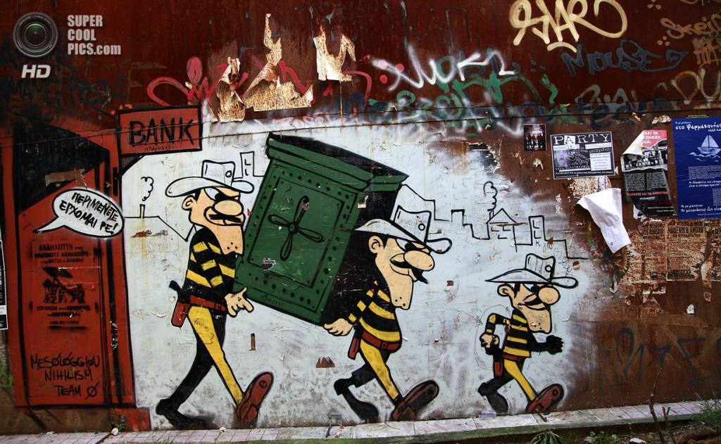 Греция. Афины. 17 февраля. Граффити, на котором изображены братья Долтоны из бельгийского комикса «Счастливчик Люк». (AP Photo/Dimitri Messinis)