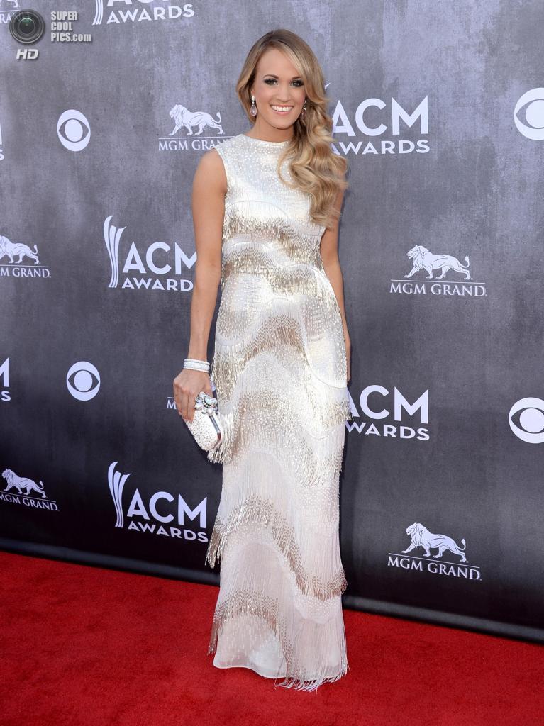США. Лас-Вегас, Невада. 6 апреля. Певица Кэрри Андервуд на красной дорожке ACM Awards 2014. (Jason Merritt/Getty Images)