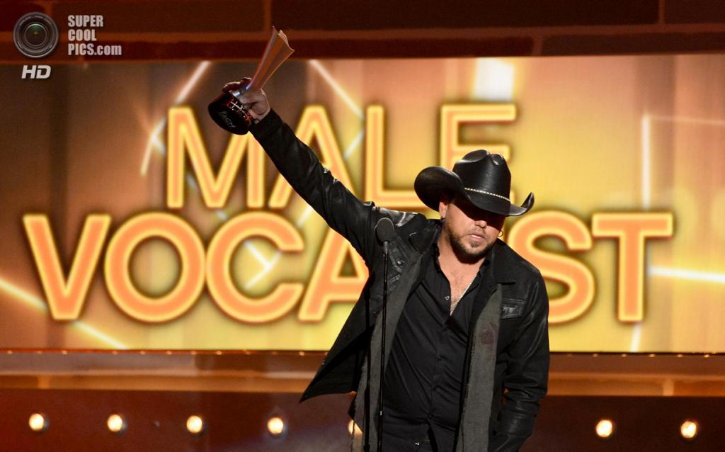 США. Лас-Вегас, Невада. 6 апреля. Джейсон Олдин получает премию ACM Awards 2014 в номинации «Вокалист года». (Ethan Miller/Getty Images)