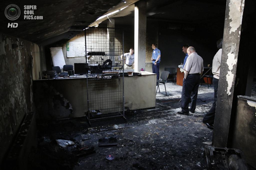 Украина. Одесса. 28 мая. Сожжённый областной штаб ВО «Свобода». (REUTERS/Yevgeny Volokin)