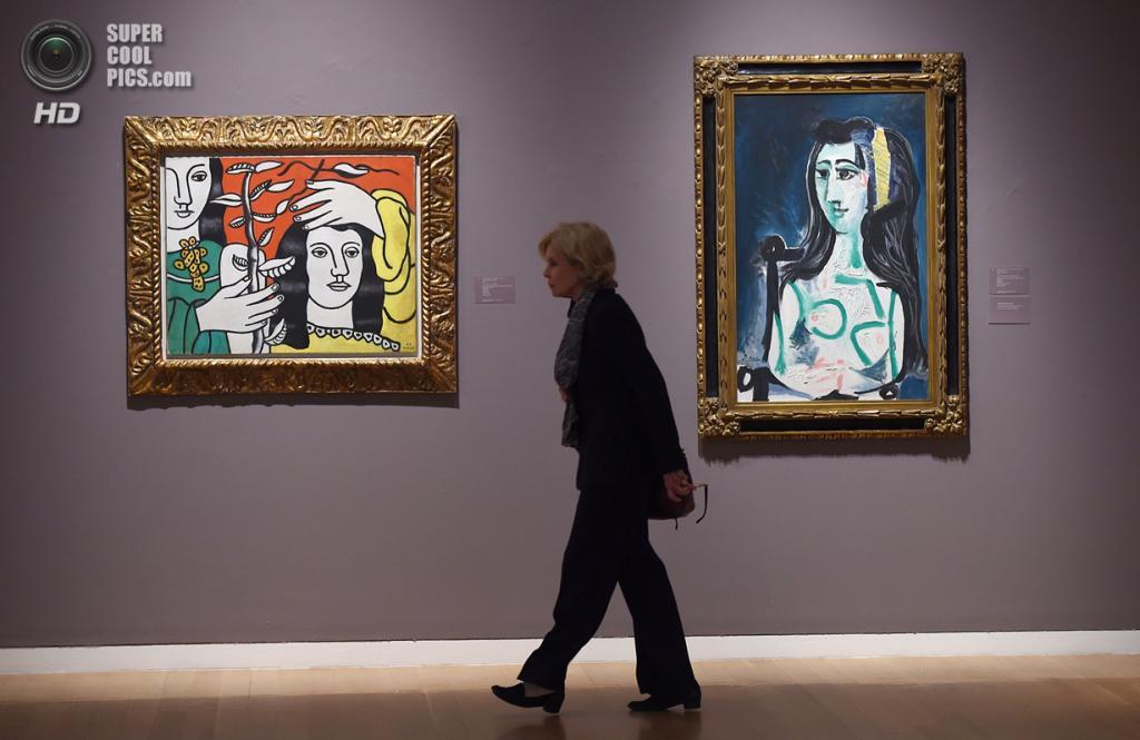 США. Нью-Йорк. 2 мая. Картины Фернана Леже «Deux figures et une fleur» и Пабло Пикассо «Femme assise dans un fauteuil (Buste de Jacqueline)» на выставке аукционного дома «Сотбис». (EMMANUEL DUNAND/AFP/Getty Images)
