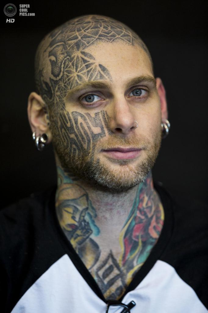 Великобритания. Лондон. 24 мая. Во время The Great British Tattoo Show 2014. (Tristan Fewings/Getty Images)