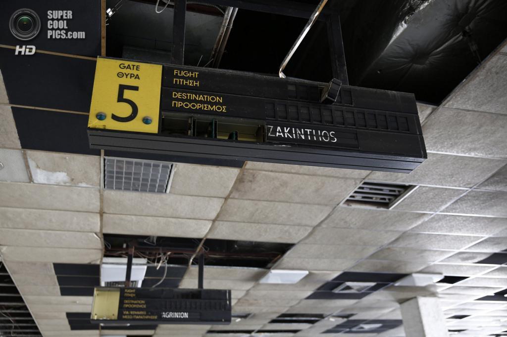Греция. Афины. 16 июня. Врата №5. (REUTERS/Yorgos Karahalis)