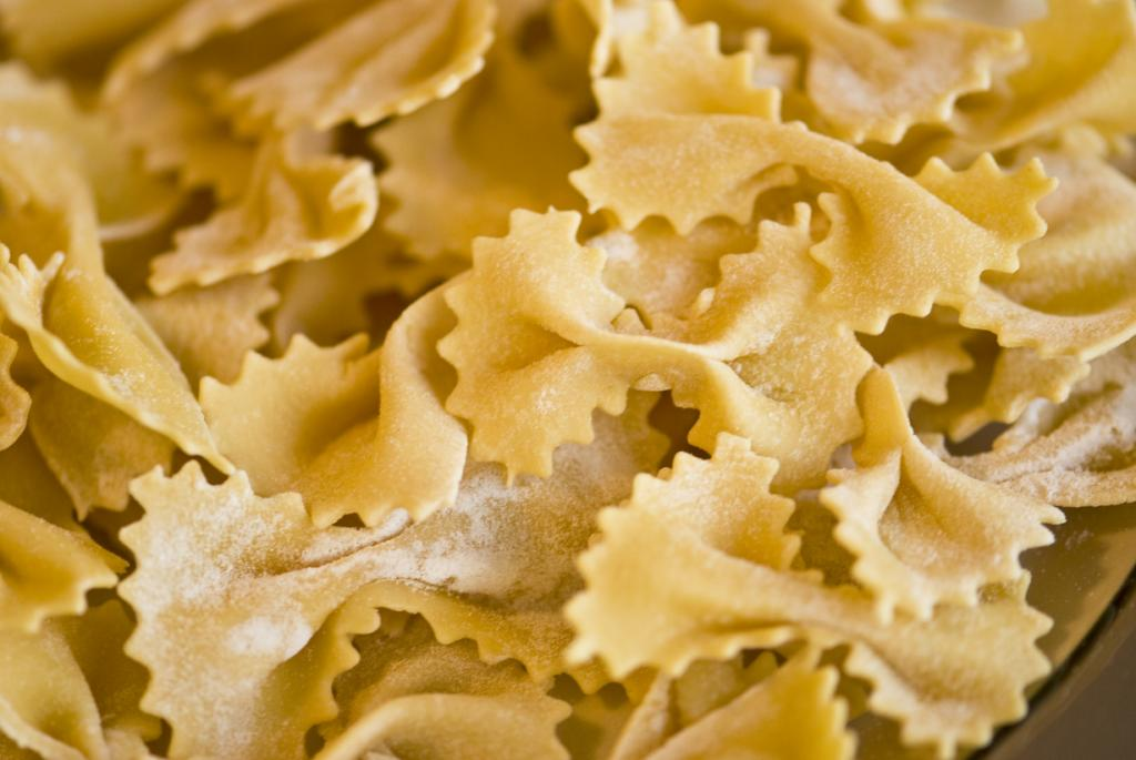 "Farfalle - pasta in the form of ribbons or butterflies.  The name comes from the Italian word «farfalle», which means ""butterfly"".  Dish originally from Lombardy and Emilia-Romagna.  Farfalle is often used as an ingredient in salads or stews.  (Madlyinlovewithlife)"