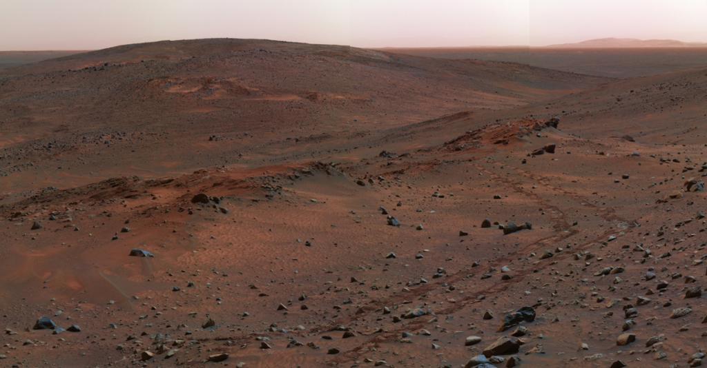 Поверхность Марса красного цвета из-за наличия оксидов железа в почве. (NASA/JPL)
