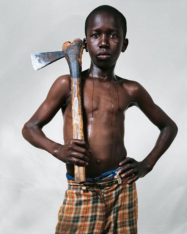 12-летний Ламине, Сенегал.