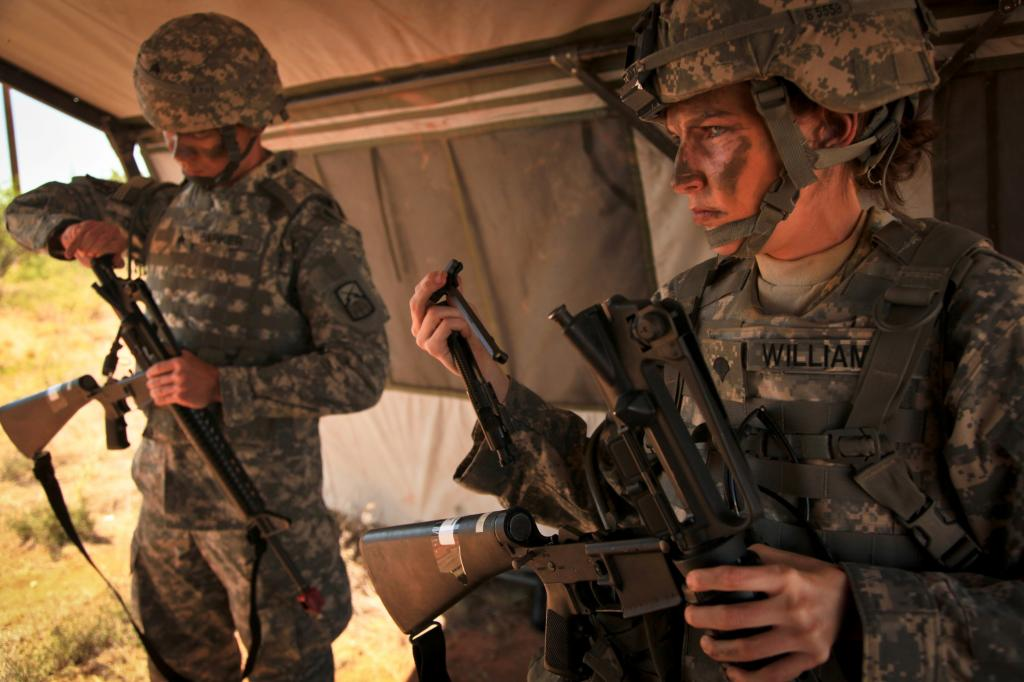 U.S. Army Sgt. Phillip Barker (left), assigned to the 160th Signal Brigade, and Spc. Brittany Williams (right), assigned to the 7th Signal Command, prepare to reassemble their rifles for the react to contact lane at Fort Huachuca, Ariz., on 15 June, 2010.  The react to contact lane is one of six lanes of the warrior task training drills conducted for the Non-Commissioned Officer / Soldier of the Year competition.   (U.S. Army photo by Spc. Canaan Radcliffe/Not Released)
