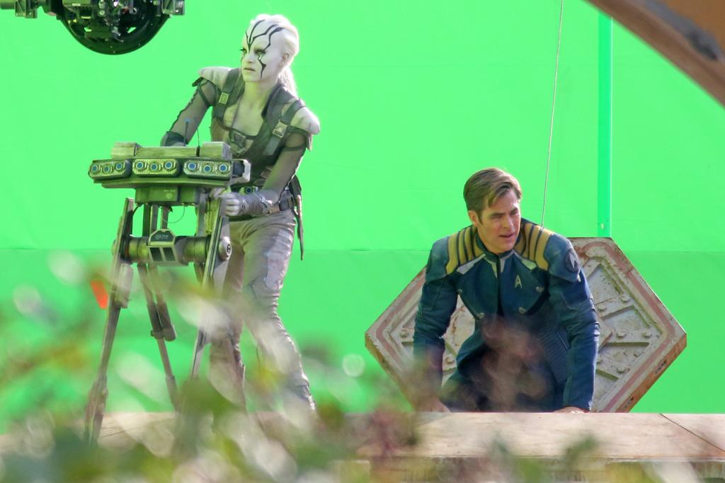 """*EXCLUSIVE* Vancouver, BC - Chris Pine, Simon Pegg, Sofia Boutella and Anton Yelchin shoot """"Star Trek Beyond"""" scenes on what looks like the top of a spaceship vessel that is surrounded by green screens while filming in Vancouver, Canada.  During a break Sophia gives Chris Pine a pat on his behind to tell him to get into the spaceship. AKM-GSI         August 17, 2015 To License These Photos, Please Contact : Steve Ginsburg (310) 505-8447 (323) 423-9397 steve@akmgsi.com sales@akmgsi.com or Maria Buda (917) 242-1505 mbuda@akmgsi.com ginsburgspalyinc@gmail.com"""