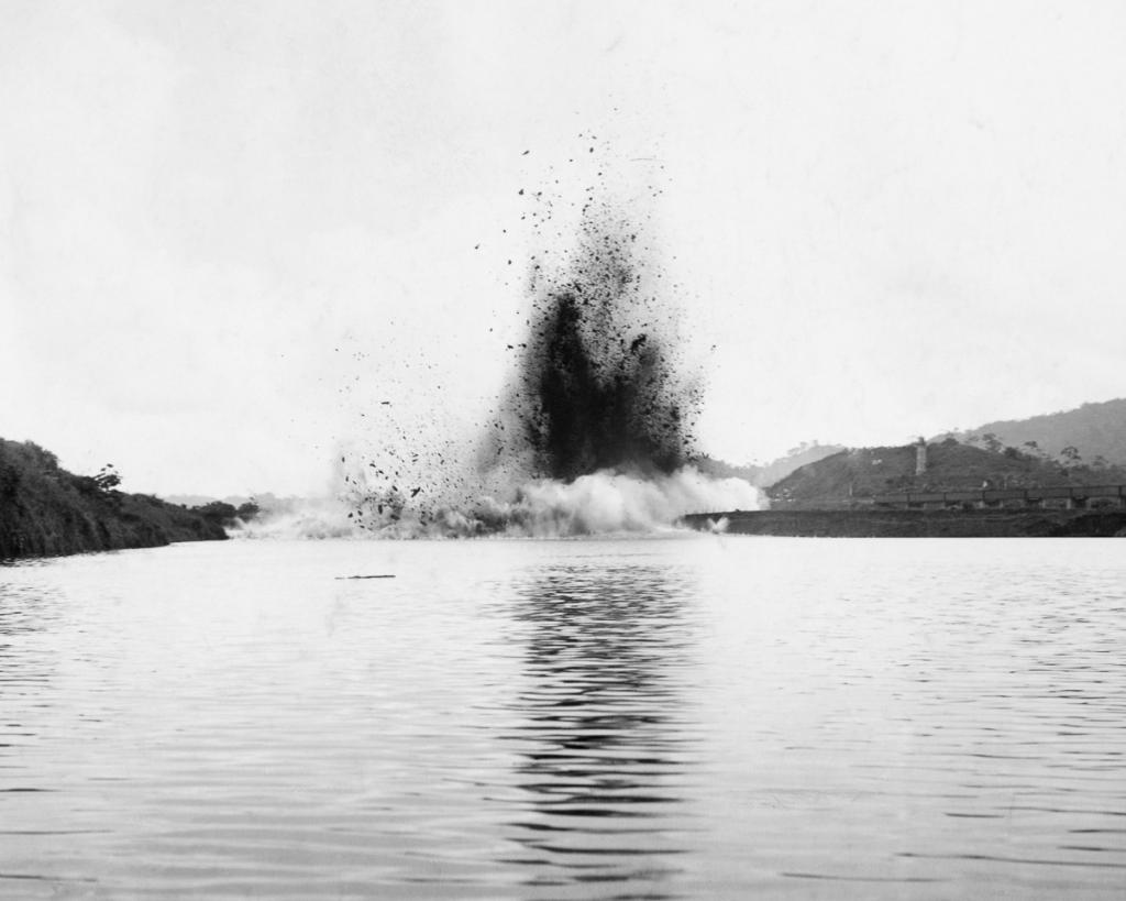The blast of Gamboa Dike clears the canal's path to the Pacific Ocean
