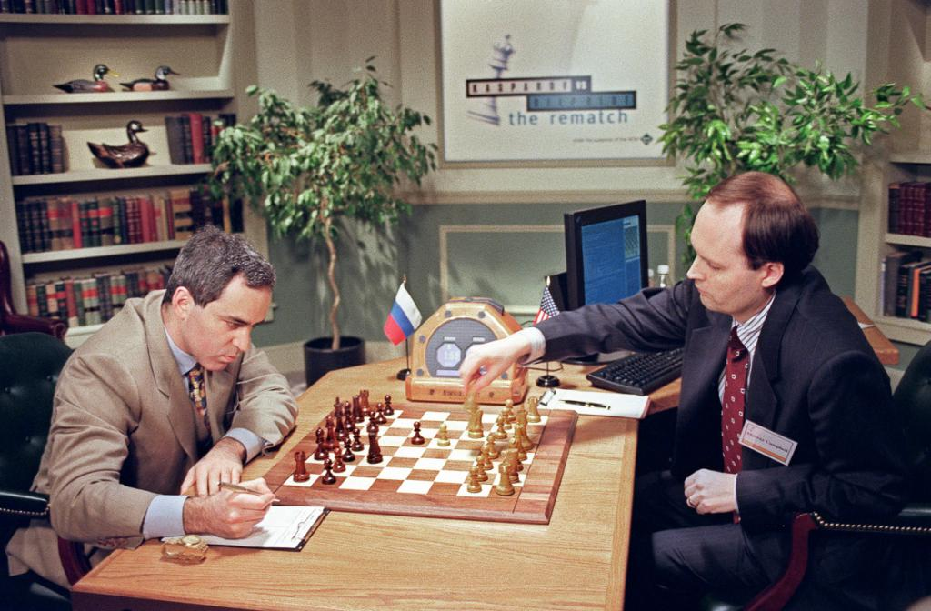 IBM scientist Murray Campbell (R) makes a move for