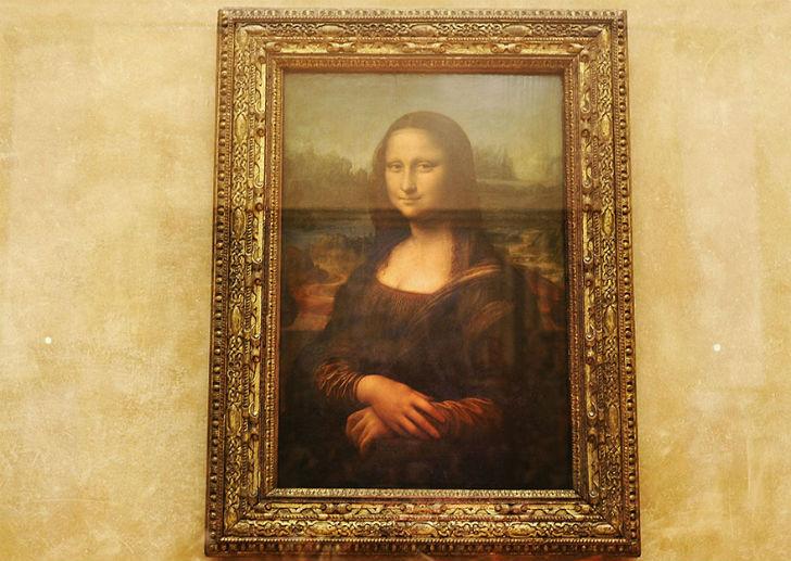 Admiring-Mona-Lisa-In-Louvre-Museum-Paris-France