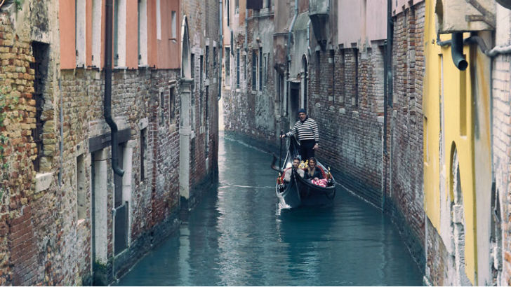 Taking-A-Peaceful-Gondola-Ride-In-Venice-Italy