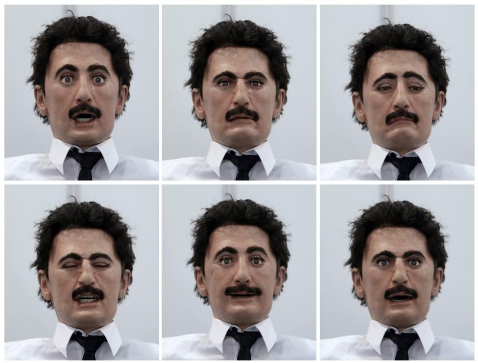 Combo picture shows robot mimicking the facial expressions of a human at the Taipei International Robot Show