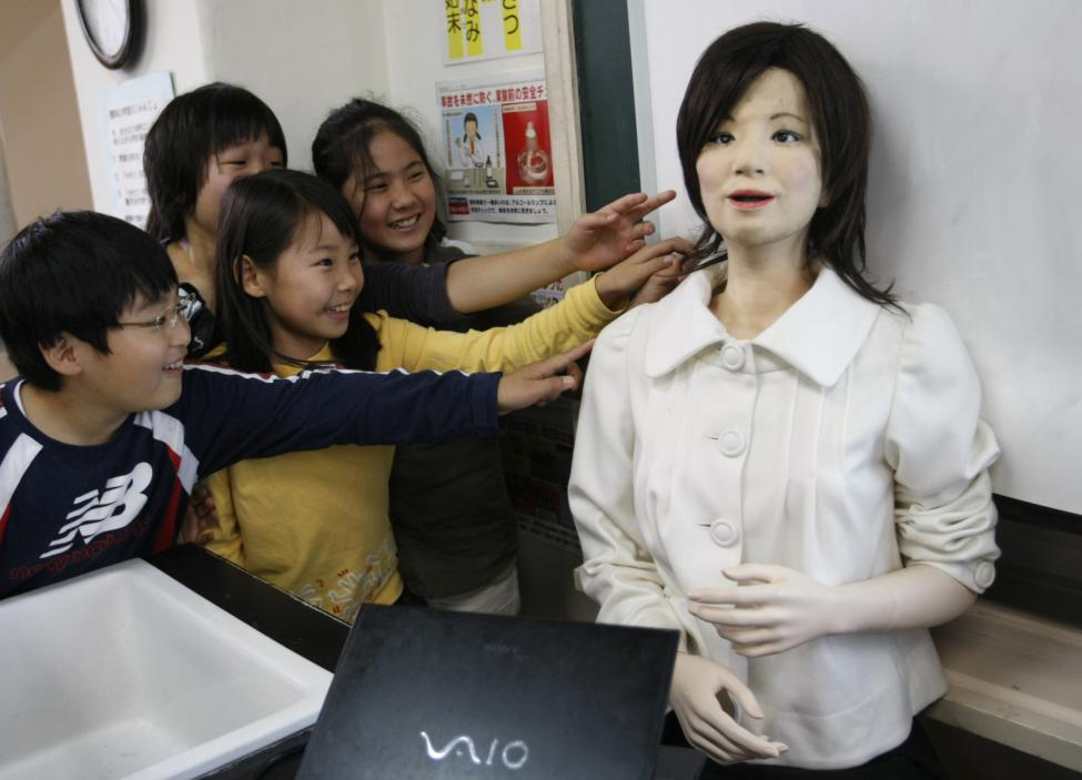 """A humanoid robot named """"Saya"""" is touched by school pupils as she takes on a role as a school teacher at an elementary school in Tokyo"""