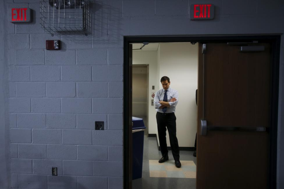 U.S. Senator and Republican presidential candidate Marco Rubio listens to the invocation from a backstage area before a campaign rally at Palm Beach Atlantic University in West Palm Beach