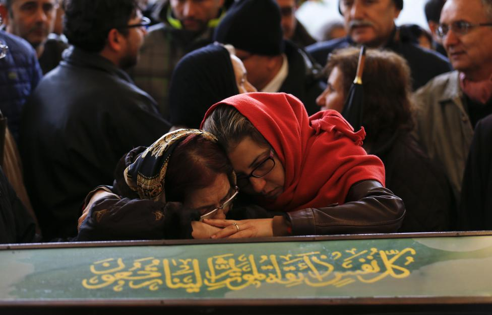 Women mourn over the coffin of a car bombing victim during a commemoration ceremony in a mosque in Ankara