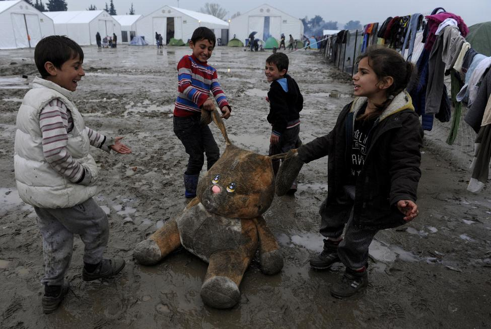 Refugee children play at a makeshift camp by the Greek-Macedonian border near the Greek village of Idomeni