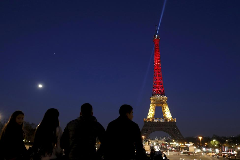 The Eiffel Tower is seen with the black, yellow and red colours of the Belgian flag in tribute to the victims of today's Brussels bomb attacks in Paris